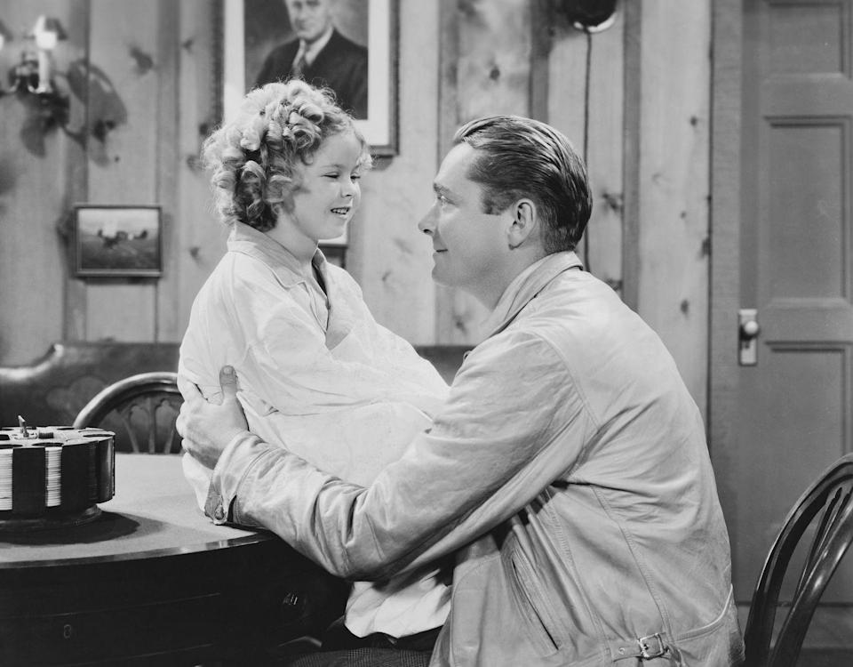 <p>James Dunn and Shirley Temple on screen together in <em>Bright Eyes</em>.</p>