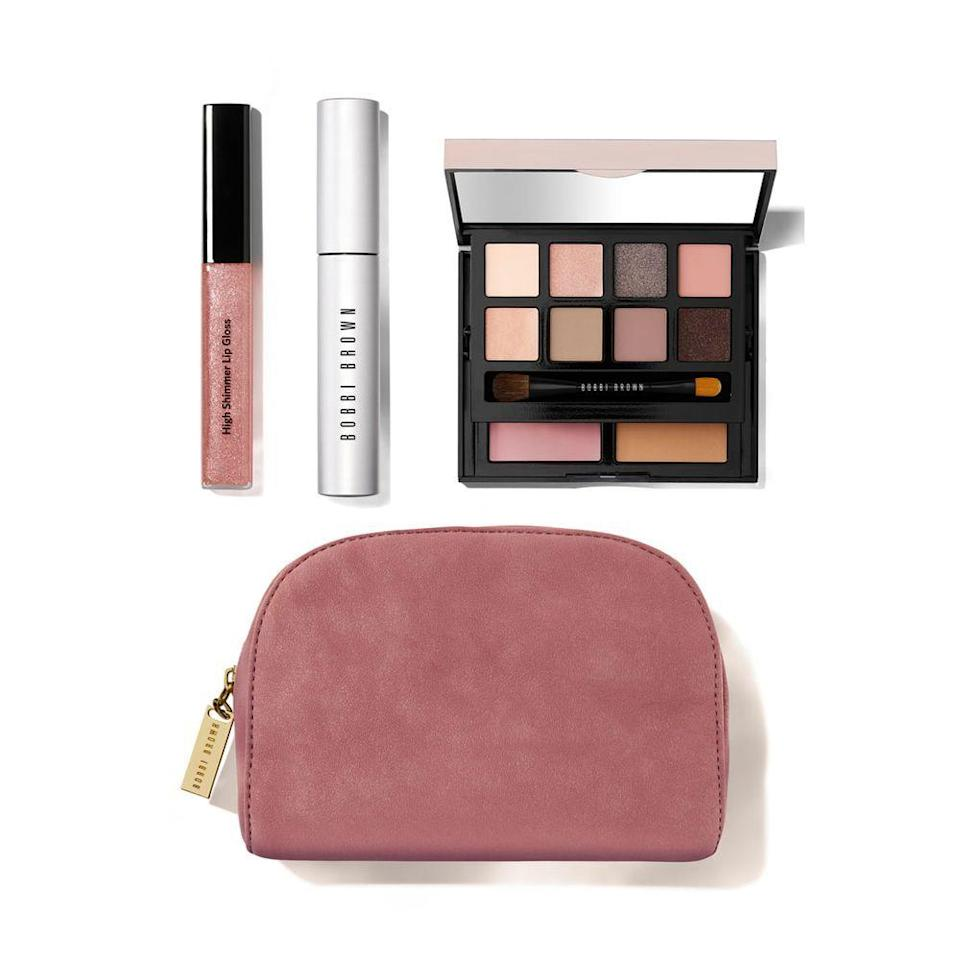 """<p><strong>BOBBI BROWN</strong></p><p>nordstrom.com</p><p><strong>$79.00</strong></p><p><a href=""""https://go.redirectingat.com?id=74968X1596630&url=https%3A%2F%2Fwww.nordstrom.com%2Fs%2Fbobbi-brown-easy-essentials-eye-cheek-lip-set-nordstrom-exclusive-250-value%2F5584588&sref=https%3A%2F%2Fwww.redbookmag.com%2Ffashion%2Fg34746885%2Fmakeup-gift-sets%2F"""" rel=""""nofollow noopener"""" target=""""_blank"""" data-ylk=""""slk:Shop Now"""" class=""""link rapid-noclick-resp"""">Shop Now</a></p><p>Just like the name implies, this curated set from Bobbi Brown comes with all the essentials — mascara, lip gloss, eyeshadow, blush, and bronzer — for a day-to-night look. It's up to her: She can go for a bolder look by adding another layer or mascara or darker eyeshadow colors.</p>"""
