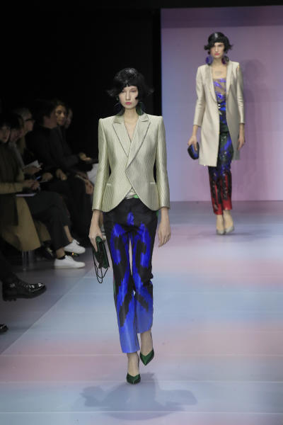 A model wears a creation for the Armani Prive Haute Couture Spring/Summer 2020 fashion collection presented Tuesday Jan. 21, 2020 in Paris. (AP Photo/Michel Euler)