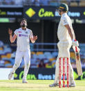 India's Mohammed Siraj, left, reacts after bowling to Australia's Cameron Green during play on the first day of the fourth cricket test between India and Australia at the Gabba, Brisbane, Australia, Friday, Jan. 15, 2021. (AP Photo/Tertius Pickard)