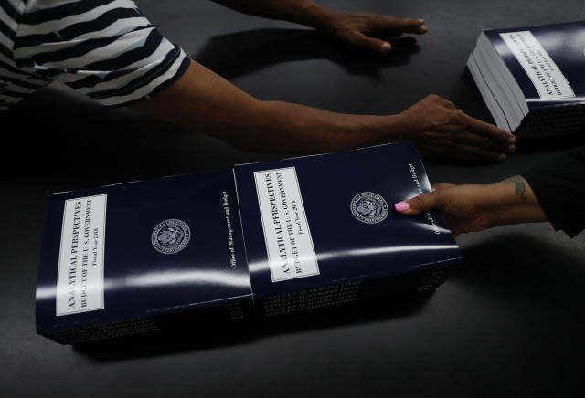 "<p>GPO workers stack and prepare copies of ""Analytical Perspectives Budget of the U.S. Government Fiscal Year 2018"", May 19, 2017, at the U.S. Government Publishing Office's (GPO) plant Washington. (Photo: Carolyn Kaster/AP) </p>"