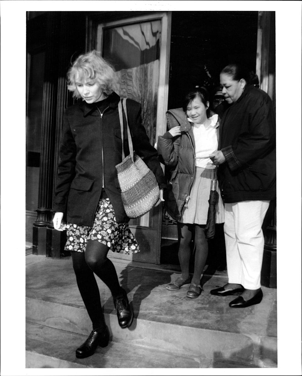 Mia Farrow emerges from her apartment. on Central Park West with daughter Tam. March 23, 1993. (Photo by Robert Kalfus/New York Post Archives /(c) NYP Holdings, Inc. via Getty Images)