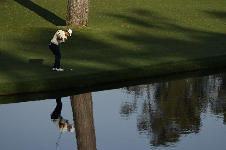 Hideki Matsuyama, of Japan, chips to the green on the 15th hole after putting his approach shop into the water during the final round of the Masters golf tournament on Sunday, April 11, 2021, in Augusta, Ga. (AP Photo/Gregory Bull)