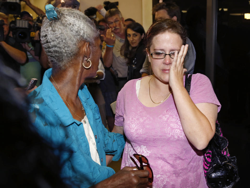 Jennifer Luna, right, the mother of 16-year-old murder suspect Chancey Luna, turns away from the media following a court appearance by her son in Duncan, Okla. on Tuesday, Aug. 20, 2013. Chancey Luna, James Edwards Jr., 15, and Michael Jones, 17, are charged in the murder of 22-year-old Australian Christopher Lane, who was on a baseball scholarship at East Central University in Ada, Okla. Lane was in Duncan visiting his girlfriend when he was shot and killed Friday, Aug. 16, 2013. (AP Photo/Sue Ogrocki)