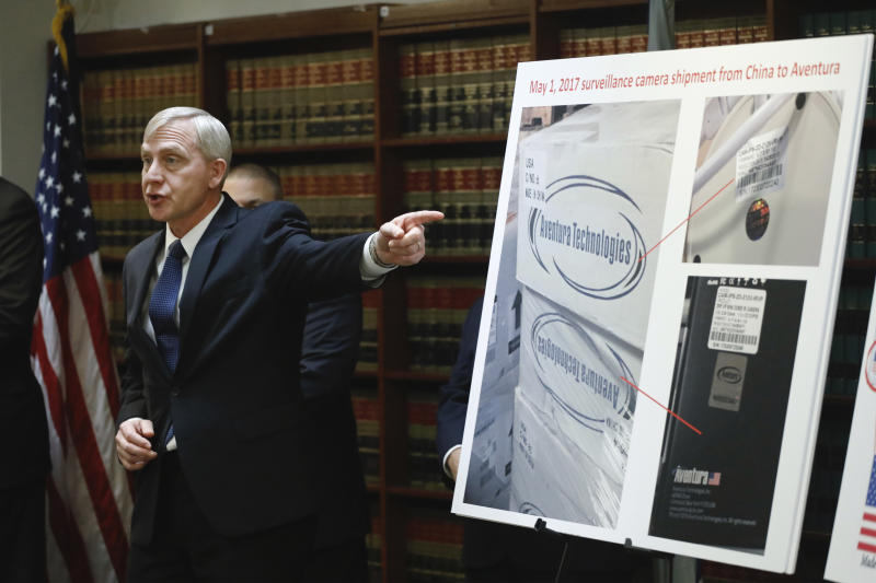 U.S. Attorney Richard P. Donoghue announces charges against Aventura Technologies, Thursday, Nov. 7, 2019, in the Brooklyn borough of New York. The New York company has been charged with illegally importing and selling Chinese-made surveillance and security equipment to U.S. government agencies and private customers. (AP Photo/Mark Lennihan)