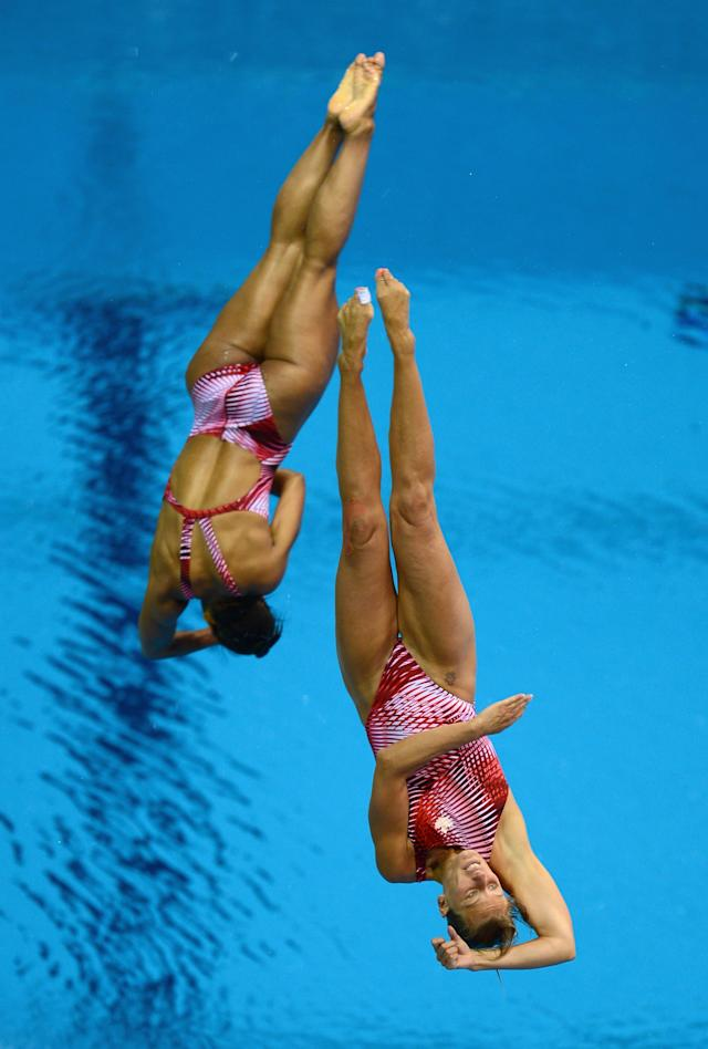 LONDON, ENGLAND - JULY 29: Emilie Heymans and Jennifer Abel of Canada dive during the Women's Synchronized 3m Springboard Final at the London 2012 Olympic Games on July 29, 2012 in London, England. (Photo by Julia Vynokurova/Getty Images)