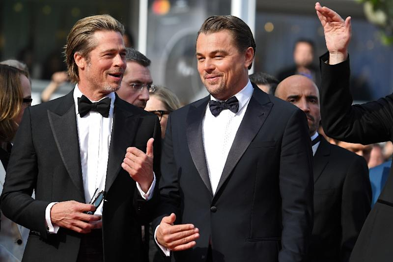 """US actor Brad Pitt (L) and US actor Leonardo DiCaprio -- seen at the Cannes screening of their new film """"Once Upon a Time... in Hollywood"""" -- have been pushing boundaries for 30 years (AFP Photo/LOIC VENANCE)"""