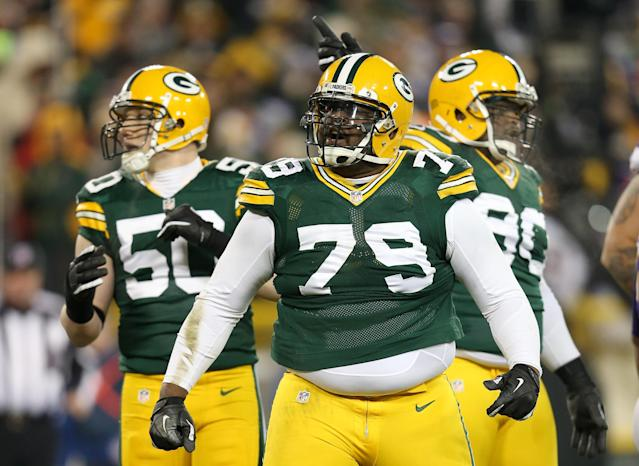GREEN BAY, WI - JANUARY 05: (C) Defensive end Ryan Pickett #79 of the Green Bay Packers reacts in front of teammates inside linebacker A.J. Hawk #50 and nose tackle B.J. Raji #90 in the second quarter against the Minnesota Vikings during the NFC Wild Card Playoff game at Lambeau Field on January 5, 2013 in Green Bay, Wisconsin. (Photo by Andy Lyons/Getty Images)