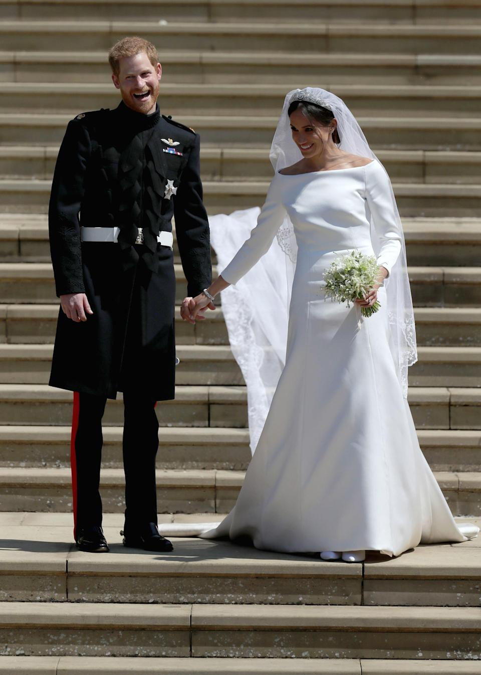 <p>Meghan's double-bonded silk cady bridal gown with bateau neckline, designed by Clare Waight Keller for Givenchy, is estimated to have cost anywhere between £200,000 and £400,000 [Photo: Getty] </p>