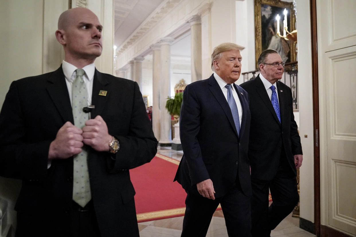 A Secret Service agent with Donald Trump and Jack Keane