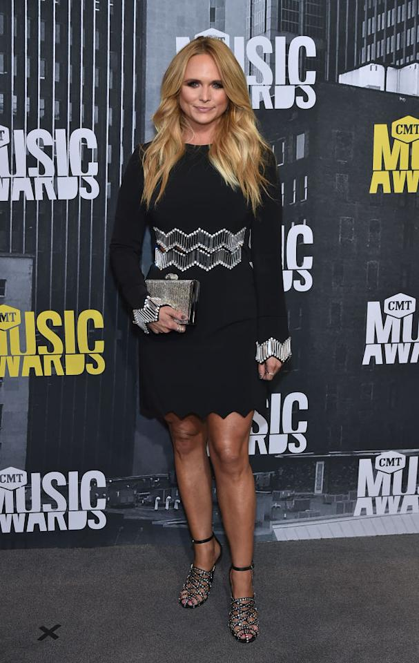 <p>The country superstar showed off her gorgeous gams in a perfect LBD. (Photo: Getty Images) </p>