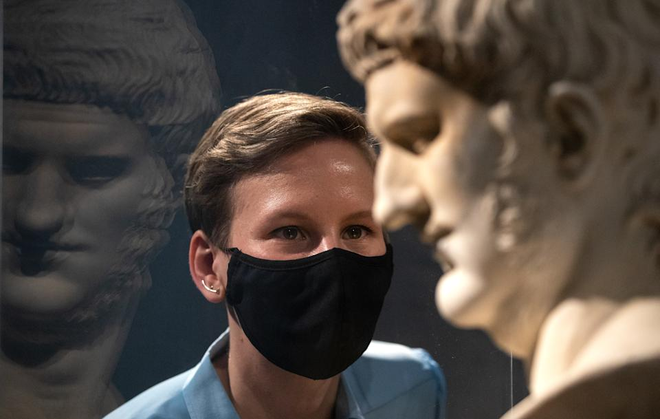 Francesca Bologna, Project Curator of 'Nero: the man behind the myth', inspects a marble head of Nero (AD 50Ð100), on loan from the Musei Capitolini in Rome, ahead of the opening of the exhibition on the Roman Emperor Nero on 27th May at the British Museum, London. Picture date: Tuesday May 18, 2021. Picture date: Tuesday May 18, 2021. (Photo by Andrew Matthews/PA Images via Getty Images)
