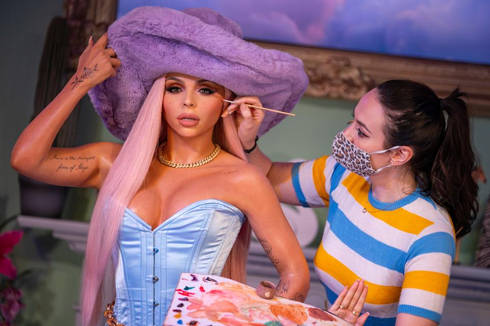 A staff member put the finishing touches to the wax figure of Jesy Nelson as Little Mix are unveiled at Madame Tussauds London. Picture date: Wednesday July 28, 2021.