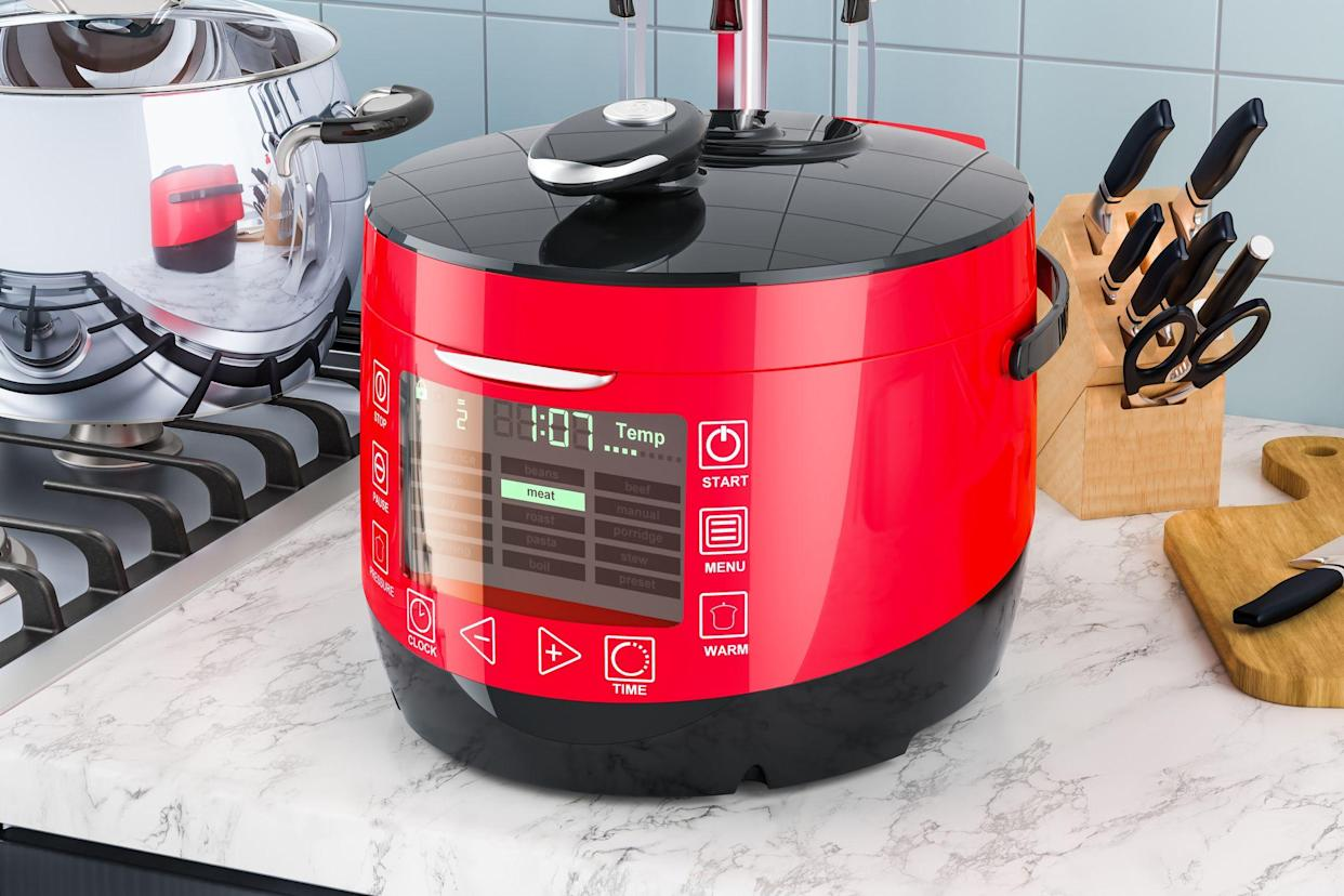 Automatic Multicooker on the kitchen table. 3D rendering