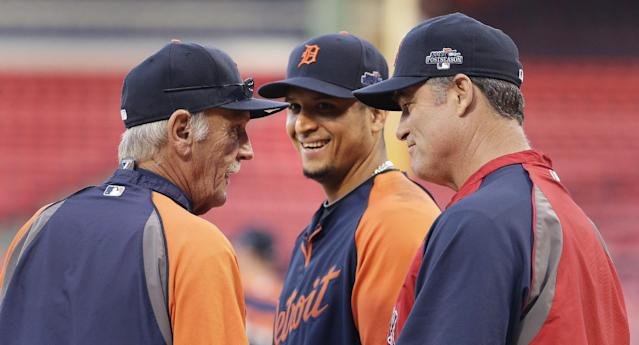 Detroit Tigers manager Jim Leyland, left, talks with Boston Red Sox manager John Farrell, right, during a baseball workout at Fenway Park in Boston, Friday, Oct. 11, 2013. The Tigers will face the Red Sox in Game 1 of the American League championship series on Saturday. At center is Tigers designated hitter Victor Martinez. (AP Photo/Charlie Riedel)