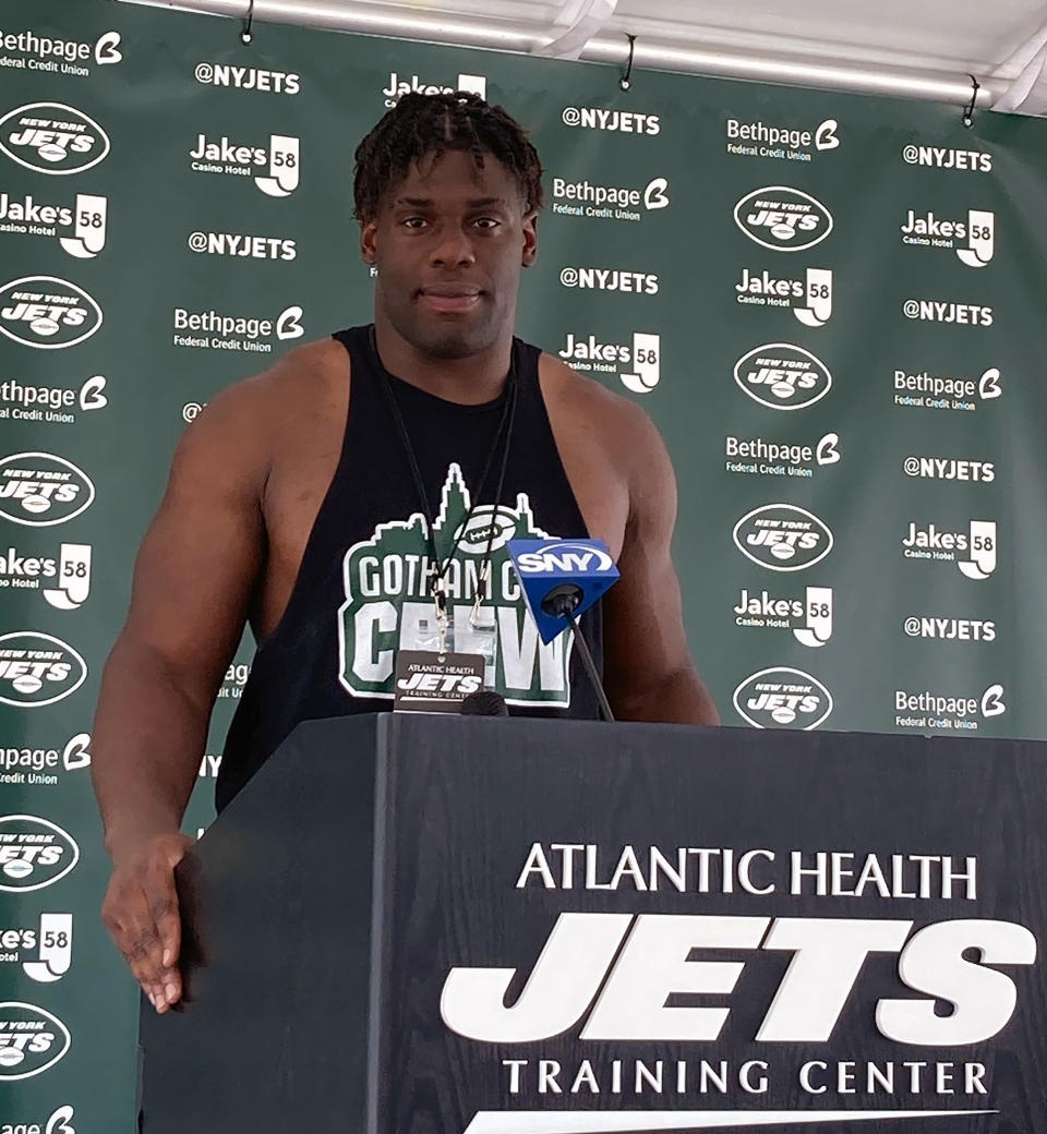 New York Jets defensive end Carl Lawson speaks to reporters at the team's NFL football training camp facility in Florham Park, N.J., Tuesday July 27, 2021. (AP Photo/Dennis Waszak Jr.)