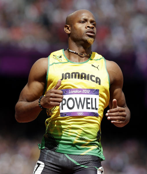 FILE - In this Aug. 4, 2012 file photo, Jamaica's Asafa Powell competes in a men's 100-meter heat at the 2012 Summer Olympics in London. Powell has been banned from his sport for 18 months. The 31-year-old sprinter tested positive for the banned stimulant oxilofrone at Jamaica's national trials last June. (AP Photo/Anja Niedringhaus, File)