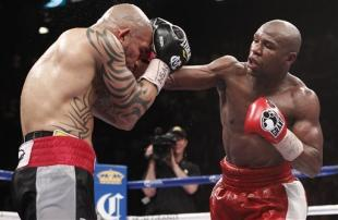 Floyd Mayweather Jr. lands a punch against Miguel Cotto. (AP)