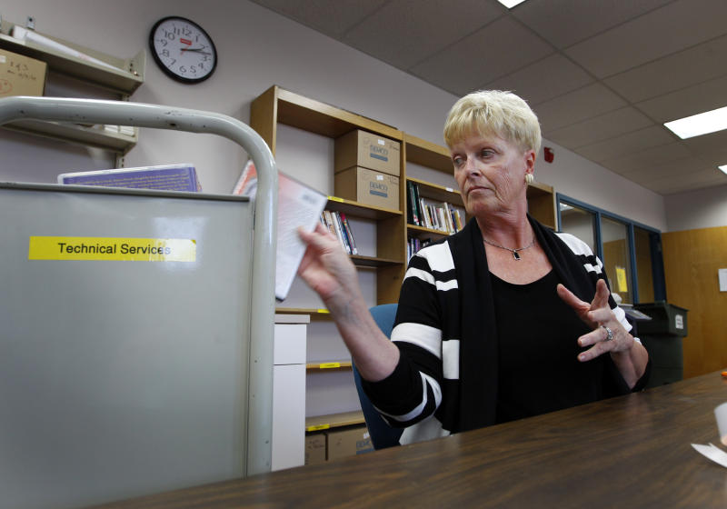 In this photo taken Oct. 4, 2012, Carol Fentiman works at her volunteer job at the library in Hendersonville, N.C. North Carolina's population has nearly doubled since 1970, fueled by an economic renaissance built around banking, health care, technology and widely regarded universities. The result is a presidential battleground. Transplants like Carol Fentiman, a 66-year-old retiree brought her Democratic politics with her, the kind of voter that helped make Barack Obama the first Democratic presidential nominee to win here since 1976. (AP Photo/Chuck Burton)