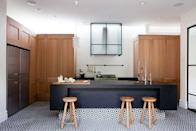 <p>If a classic stainless steel hood feels too commercial or stark in your space, you don't necessarily have to replace it altogether. In this kitchen, Hecker Guthrie found a clever solution: Hiding it behind a pretty glass partition. This adds graphic fun and also polishes things off. </p>