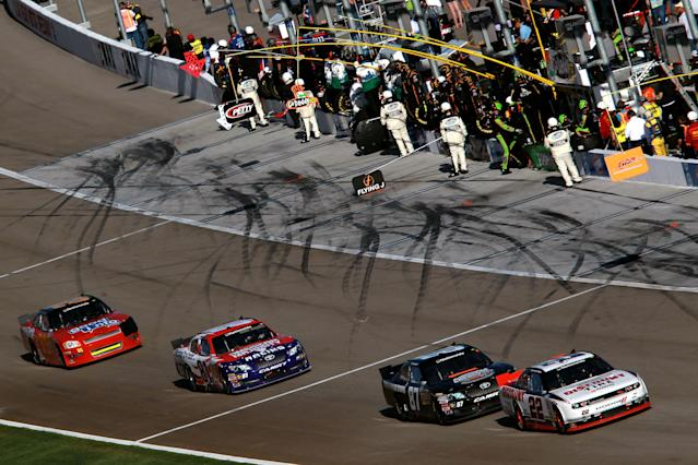 LAS VEGAS, NV - MARCH 10: Brad Keselowski, driver of the #22 Discount Tire Dodge, leads a pack of cars off pit road during the NASCAR Nationwide Series Sam's Town 300 at Las Vegas Motor Speedway on March 10, 2012 in Las Vegas, Nevada. (Photo by Ronald Martinez/Getty Images for NASCAR)