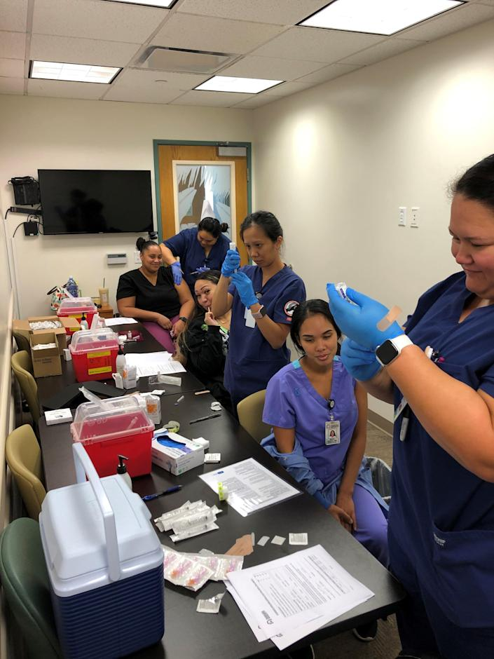 In 2019, healthcare providers receive a flu shot. Photo courtesy of the Immunization Action Coalition.