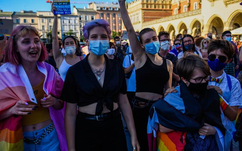 Protesters join a demo against discrimination against the LGBT community in Krakow, two days before the election - Getty