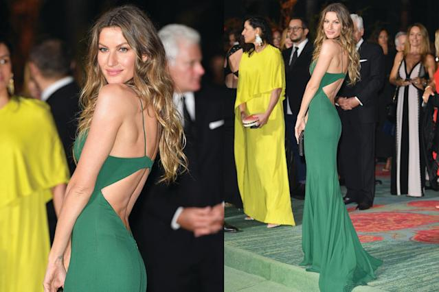 Gisele Bündchen wore a gorgeous green dress on the green carpet at Milan Fashion Week. (Photo: Getty Images)