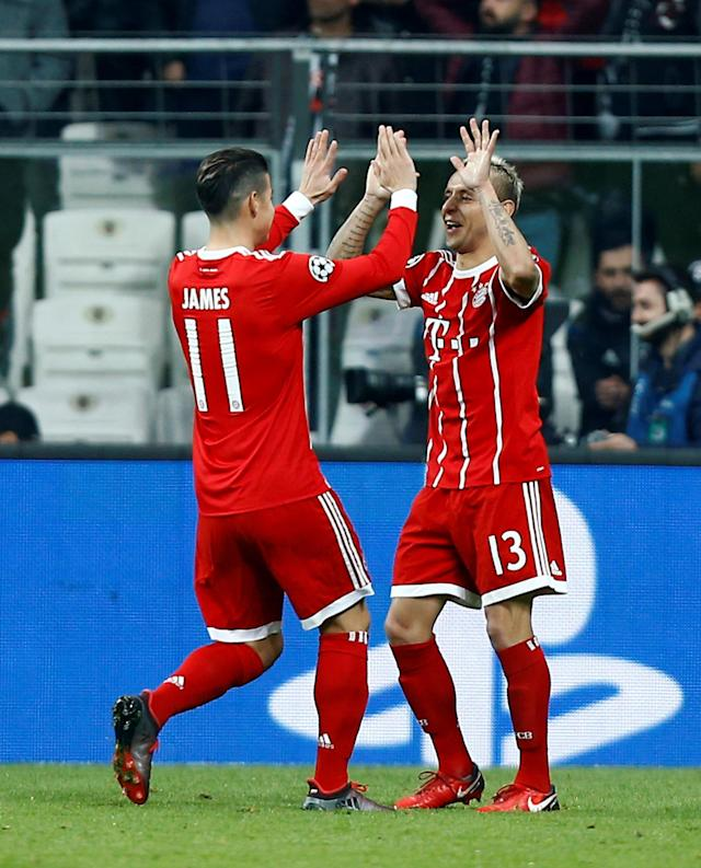 Soccer Football - Champions League Round of 16 Second Leg - Besiktas vs Bayern Munich - Vodafone Arena, Istanbul, Turkey - March 14, 2018 Bayern Munich's Rafinha celebrates with James Rodriguez after Besiktas' Gokhan Gonul (not pictured) scores an own goal and the second goal for Bayern Munich REUTERS/Osman Orsal