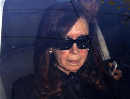 Argentina's President Fernandez sits in a car as she arrives at hospital in Buenos Aires