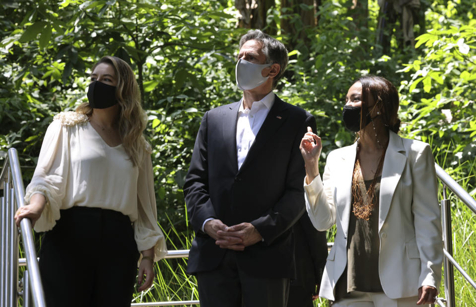 U.S. Secretary of State Antony Blinken listens to Costa Rica's first lady Claudia Dobles and Minister of Environment Andrea Meza, right, during a visit to see Rutas Naturbanas and of the launch of National Land Use, Land Cover, and Ecosystems Monitoring System (SIMOCUTE), Wednesday, June 2, 2021, in San Jose, Costa Rica. (Evelyn Hockstein/Pool via AP)