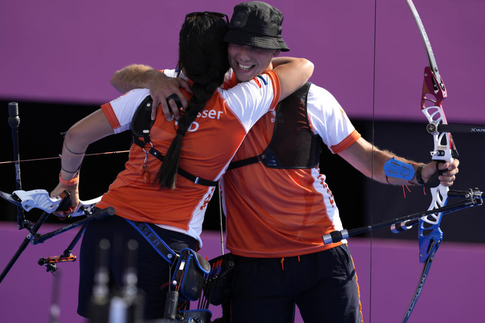 Second placed Gabriela Schloesser and Steve Wijler of the Netherlands celebrate at the end the mixed team quarterfinals against France at the 2020 Summer Olympics, Saturday, July 24, 2021, in Tokyo, Japan. (AP Photo/Alessandra Tarantino)