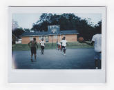Youths play basketball at an outdoor court, Tuesday, Oct. 6, 2020, in Meridian, Miss. (AP Photo/Wong Maye-E)