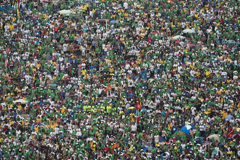 FILE - In this July 28, 2013 file photo, people attend the World Youth Day's closing Mass celebrated by Pope Francis on the Copacabana beachfront, in Rio de Janeiro, Brazil. Brazilian researchers say the Roman Catholic Church's 3.7 million estimate of the crowd that turned out to see Francis celebrate Mass on Copacabana beach is inflated, if still impressive. One of Brazil's top polling and research firms estimates the crowd at the Mass was at most 1.5 million people. (AP Photo/Felipe Dana, File)