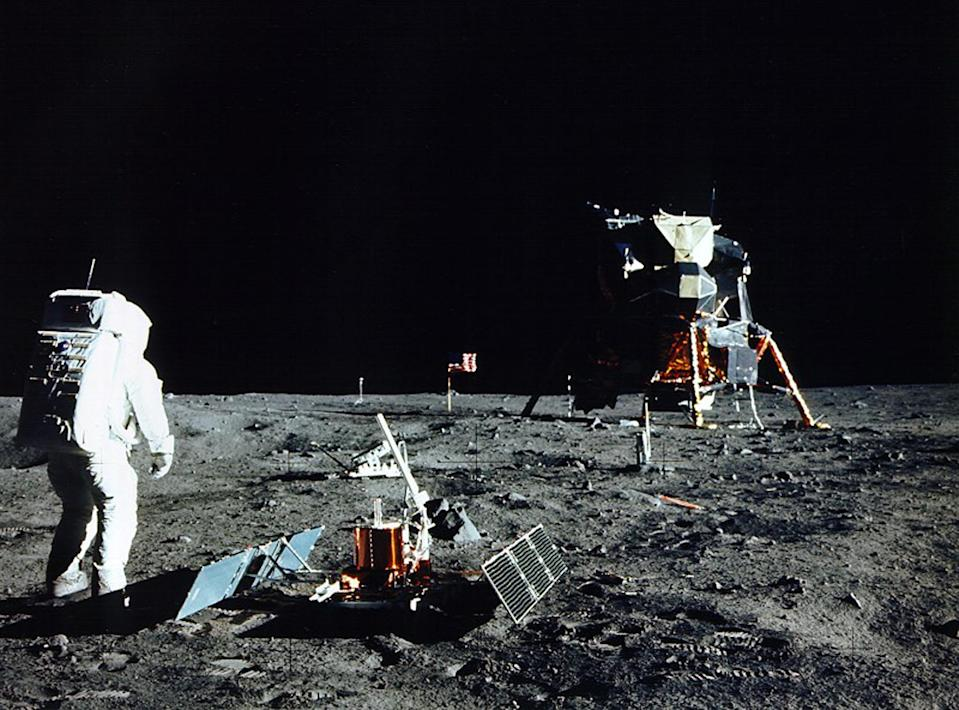 JULY 1969 FILE PHOTO - Astronaut Edwin E. Aldrin Jr., lunar module pilot, is photographed during the Apollo 11 extravehicular activity on the Moon in this July, 1969 file photo. He had just deployed the Early Apollo Scientific Experiments Package (EASEP). In the foreground is the Passive Seismic Experiment Package (PSEP); beyond it is the Laser Ranging RetroReflector (LR-3); in the center background is the United States flag; in the left background is the black and white lunar surface television camera; in the far right background is the Lunar Module. Astronaut Neil A. Armstrong took this photograph with a 70mm lunar surface camera. July 16 marks the 30th anniversary of the Apollo 11 launch.    SV/JP