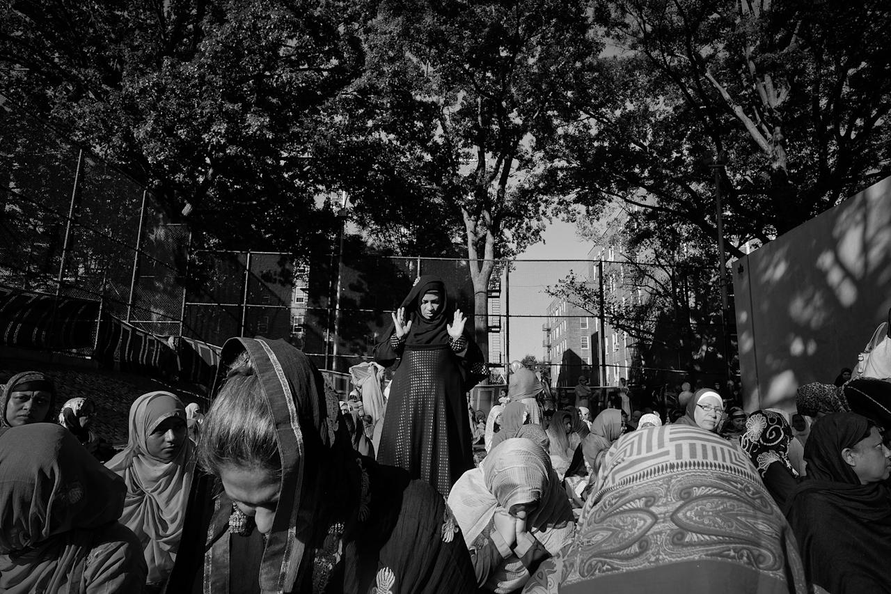 <p>Muslim women during morning Eid prayers in a handball court in Travers Park in Jackson Heights, Queens, N.Y., in September 2015. (Photo: Yunghi Kim/Contact Press Images) </p>