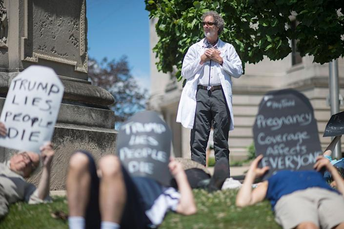 """<p>Robert Stone, a local doctor and member of Physicians for a National Health Program, oversees a handful of protesters as local concerned citizens gather to protest the current health care bill being considered in the Senate with a """"Die-in"""" at the Monroe County Courthouse in Bloomington, Ind. Monday, June 26, 2017. (Photo: Chris Howell/The Herald-Times via AP) </p>"""