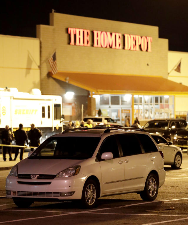 <p>A vehicle is surrounded by a police perimeter in the parking lot of a Home Depot store, Tuesday, Oct. 31, 2017, in Passaic, N.J. Police investigating a rented Home Depot truck's deadly rampage down a bike path near New York's World Trade Center have surrounded the white Toyota minivan with Florida plates parked in a New Jersey Home Depot lot. (Photo: Julio Cortez/AP) </p>