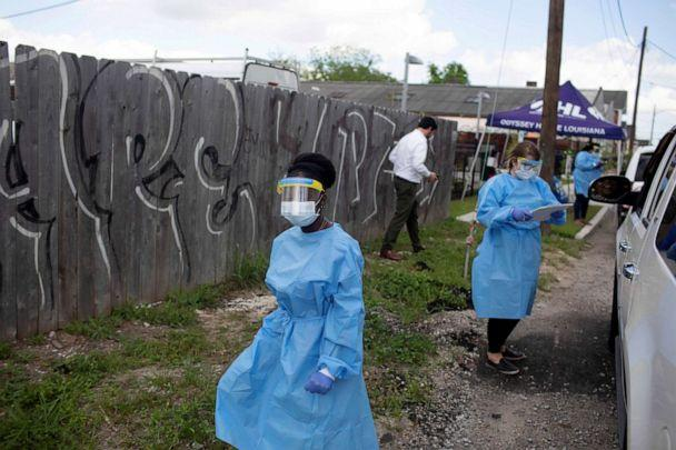 PHOTO: Staff of Odyssey House Louisiana, which runs a drive-through testing site for the coronavirus disease, work at the site in New Orleans, March 27, 2020. (Kathleen Flynn/Reuters, FILE)
