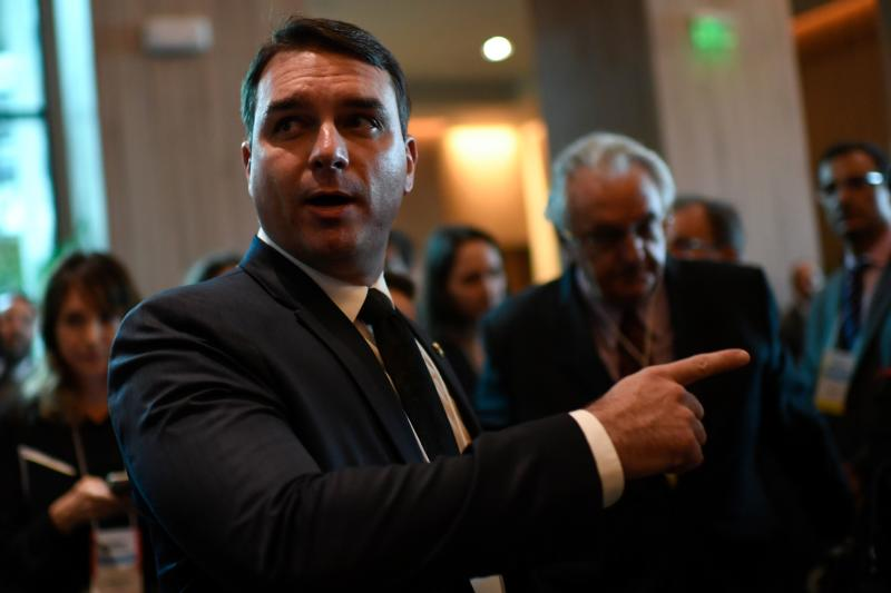 Brazil's Senator Flavio Bolsonaro gestures as he attends Brazil's government auction for offshore oil fields in Rio de Janeiro, Brazil, on November 06, 2019. - Brazil will auction drilling rights to deep-sea oil fields off its southeast coast Wednesday in a blockbuster sale it hopes will raise a whopping $26.5 billion and boost its crude sector. (Photo by Mauro Pimentel / Mauro Pimentel / AFP) (Photo by MAURO PIMENTEL/Mauro Pimentel/AFP via Getty Images)