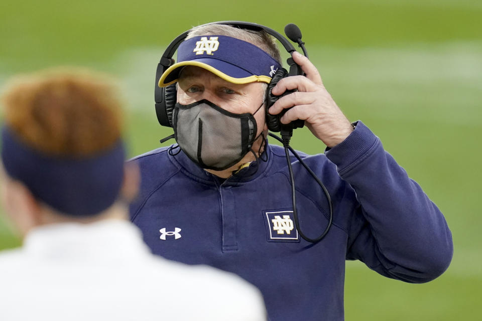Notre Dame coach Brian Kelly adjusts his headset during a game against Pittsburgh on Oct. 24. (AP)