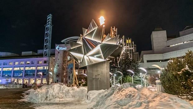 Ottawa's city government is lighting the flame on its Canada 150 cauldron every night as a tribute to its front-line workers. (Brian Morris/CBC - image credit)
