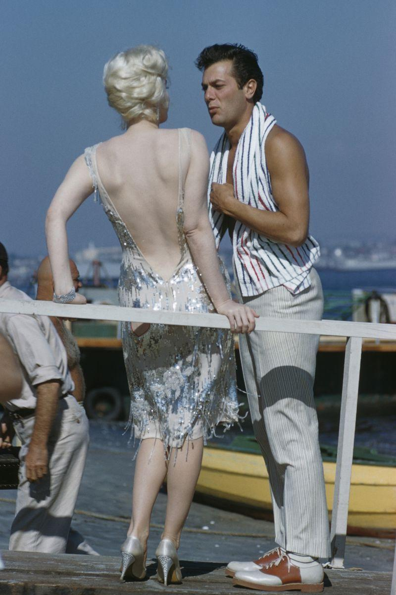 <p>Marilyn and Tony Curtis on set of the 1959 film, <em>S</em><em>ome Like It Hot</em>. The two actors played love interests Joe/Josephine and Sugar Kowalczyk, respectively. </p>