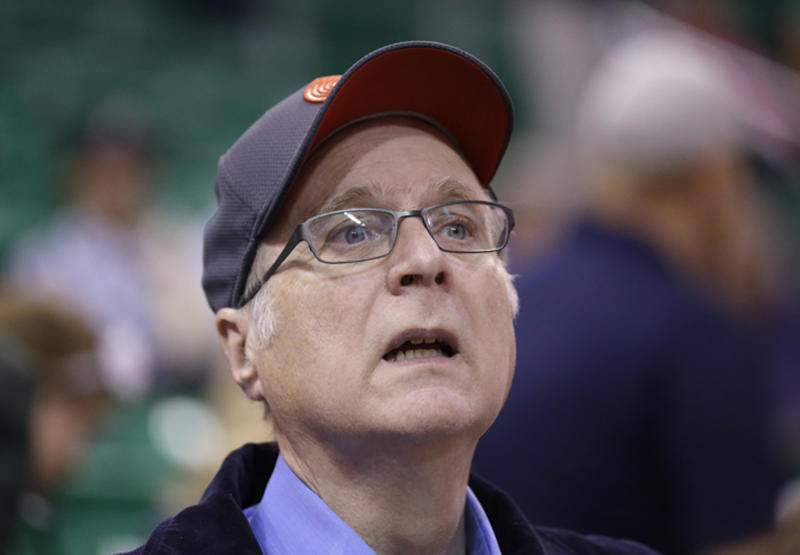 FILE - In this Oct. 12, 2015 file photo, Portland Trail Blazers owner Paul Allen looks on before the start of the first quarter of an NBA preseason basketball game against the Utah Jazz in Salt Lake City. Allen, billionaire owner of the Trail Blazers and the Seattle Seahawks and Microsoft co-founder, died Monday, Oct. 15, 2018 at age 65. Earlier this month Allen said the cancer he was treated for in 2009, non-Hodgkin's lymphoma, had returned. (AP Photo/Rick Bowmer, File)