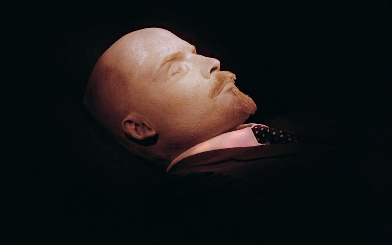 Vladimir Lenin's body lies in its glass sarcophagus on Red Square. - AFP
