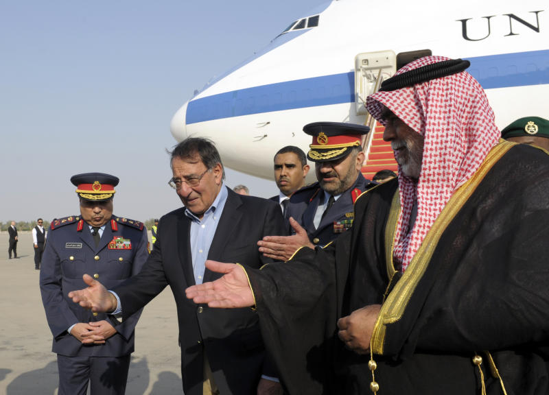 U.S. Defense Secretary Leon Panetta, second from left, is welcomed upon his arrival at Kuwait International Airport in Kuwait City, Kuwait, Tuesday, Dec. 11, 2012. Kuwaiti Defense Minister Sheik Ahmad Al-Khaled Al Sabah, right, escorts Panetta, who is scheduled to meet with troops during his visit as part of a holiday visit to thank the troops for their service. (AP Photo/Susan Walsh, Pool)
