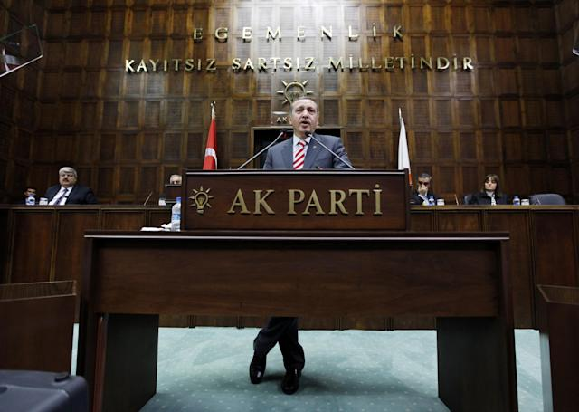<p>Turkey's Prime Minister Tayyip Erdogan addresses members of parliament from his ruling AK Party (AKP) during a meeting at the Turkish parliament in Ankara January 5, 2010. (Umit Bektas/Reuters) </p>