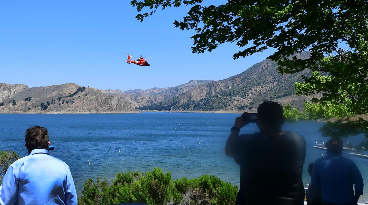 A helicopter searches over Lake Piru in Ventura County, California on July 9, 2020 for former Glee actress Naya Rivera, who was reported missing after going boating with her son on July 8. -