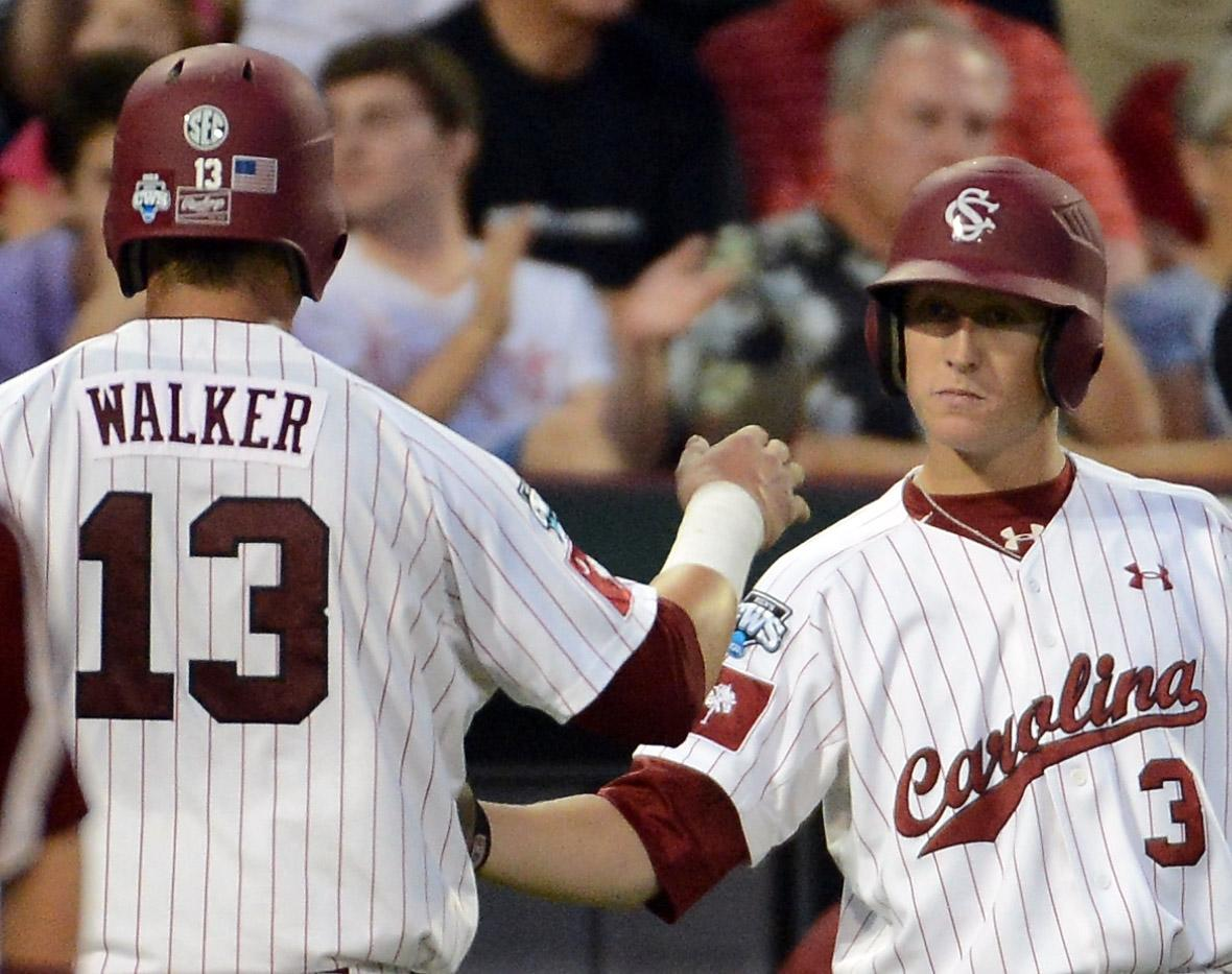 OMAHA, NE - JUNE 25:  Christian Walker #13 celebrates his run with Tanner English #3 of the South Carolina Gamecocks to tie the game 1-1 against the Arizona Wildcats in the seventh inning during game 2 of the College World Series at TD Ameritrade Field on June 25, 2012 in Omaha, Nebraska.  (Photo by Harry How/Getty Images)