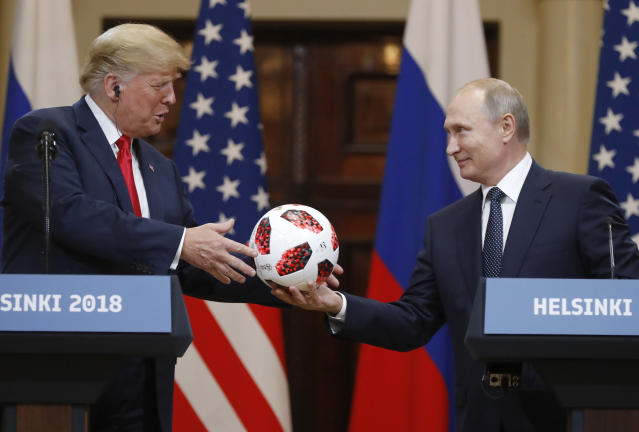 Russian President Vladimir Putin gives a soccer ball to President Trump after their meeting in Helsinki, Finland, July 16, 2018. (Photo: Alexander Zemlianichenko/AP)